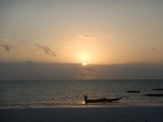Local Fisherman Getting Ready While the Sun Rises Over the Indian Ocean