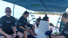 Hanging Out on the Boat Before Diving
