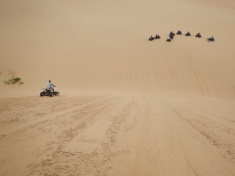 Quads Sliding Down the Steep Dune