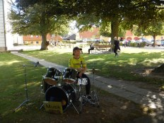 Even had a drummer to play as vehicles came and went