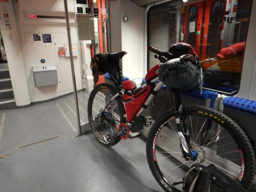 Trying to make sure my bike doesn't fall over during the train ride